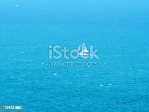 1066331604istockphoto White sailboat against the blue sea. Aerial view. Yacht with white sails 1016531562
