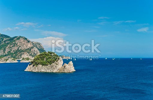 1066331604istockphoto white sailboats in sea floating among rocky islands 479831002