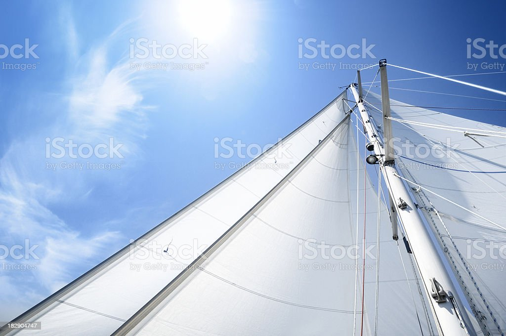 White sails of a yacht on sunny day stock photo