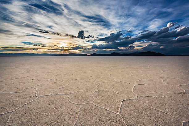White Salt Flats with sunset near Salt Lake City, Utah White Salt Flats with dramatic sunset near Salt Lake City, Utah bonneville salt flats stock pictures, royalty-free photos & images