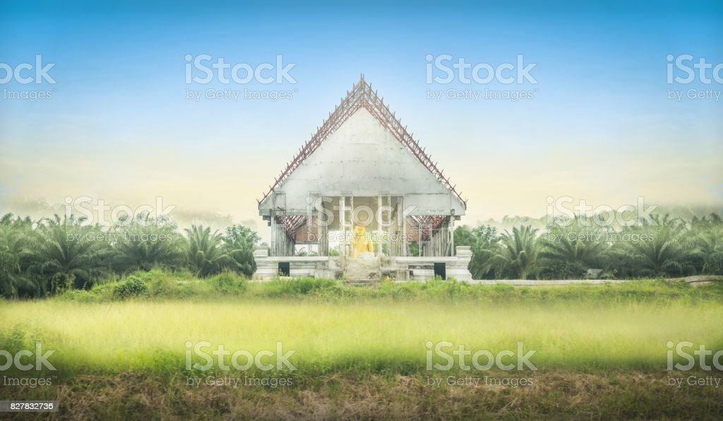 White sanctuary temple 'Wat Kuanin tanin ngam' among nature area in Trang Thailand. Beautiful landscape background and construction stock photo