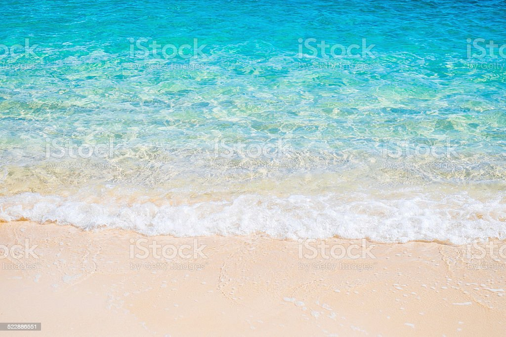 White sand beach and blue sea wave stock photo