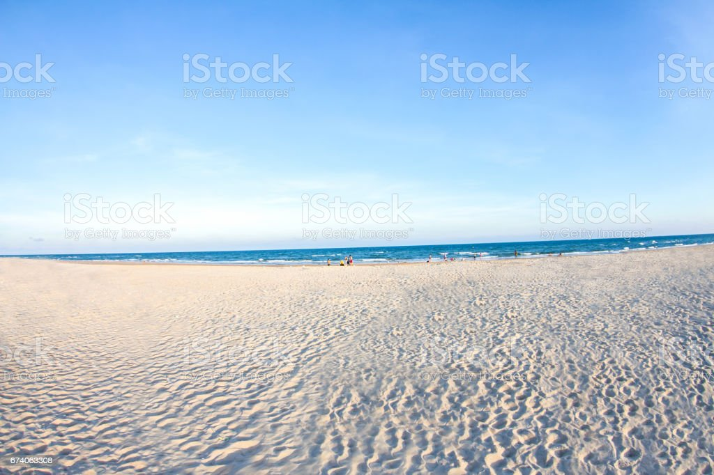 White sand beach and blue sky with people playing sea water,  background sunset royalty-free stock photo