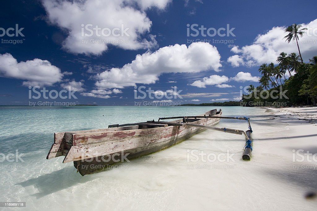 White sand beach with boat royalty-free stock photo
