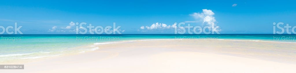 White sand beach with clear sky stock photo