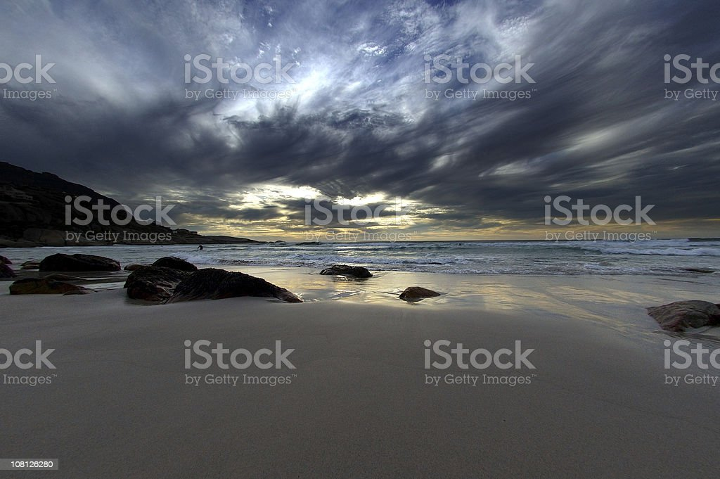 White Sand Beach with Dramatic Clouds at Sunset royalty-free stock photo