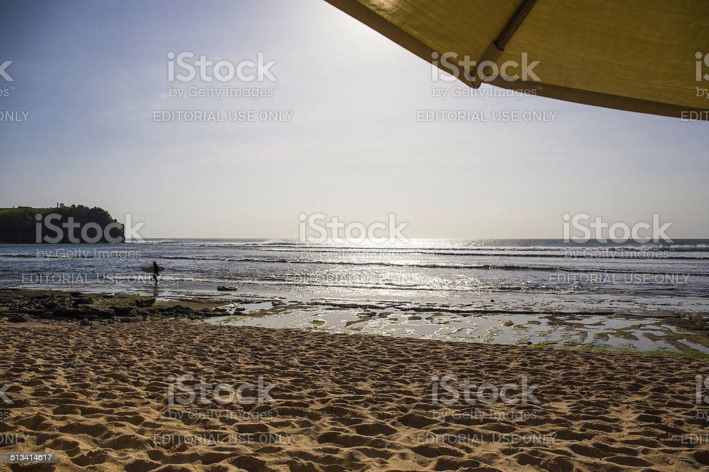 White sand, big waves and parasol for your best holidays. stock photo
