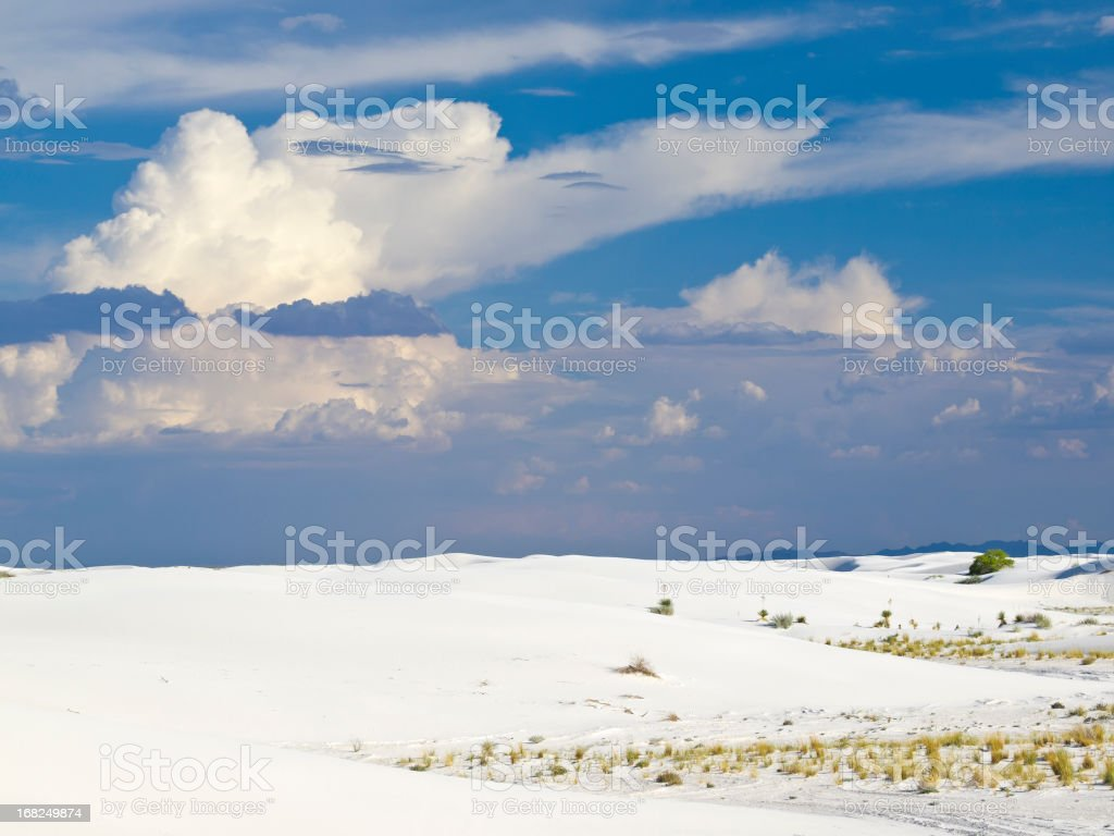 White sand desert with cloudy sky royalty-free stock photo