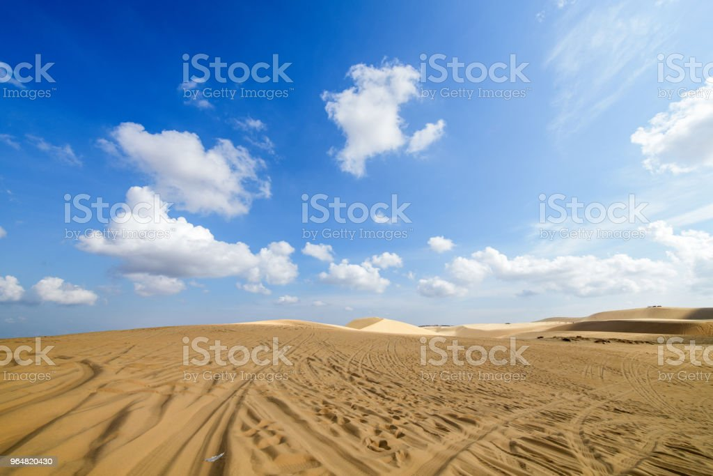 White Sand Dunes with white cloudy and blue sky royalty-free stock photo
