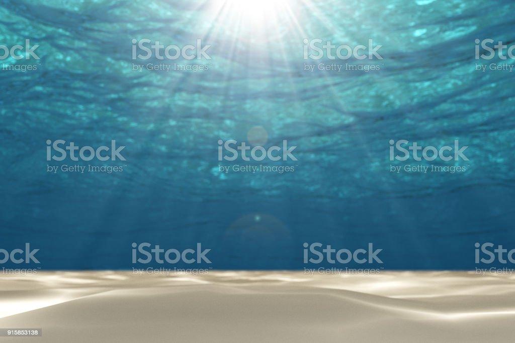 Blanc sable avec rayon lumineux et floue sous le fond de la mer. - Photo