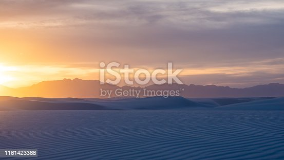 Sunset at White Sands National Monument with mountains in the background