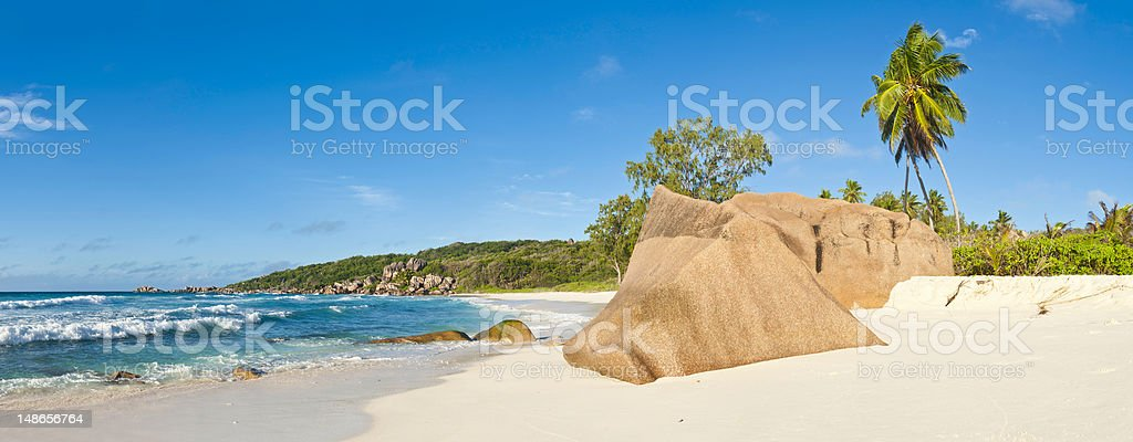 White sands surf idyllic tropical island beach palm tree paradise royalty-free stock photo