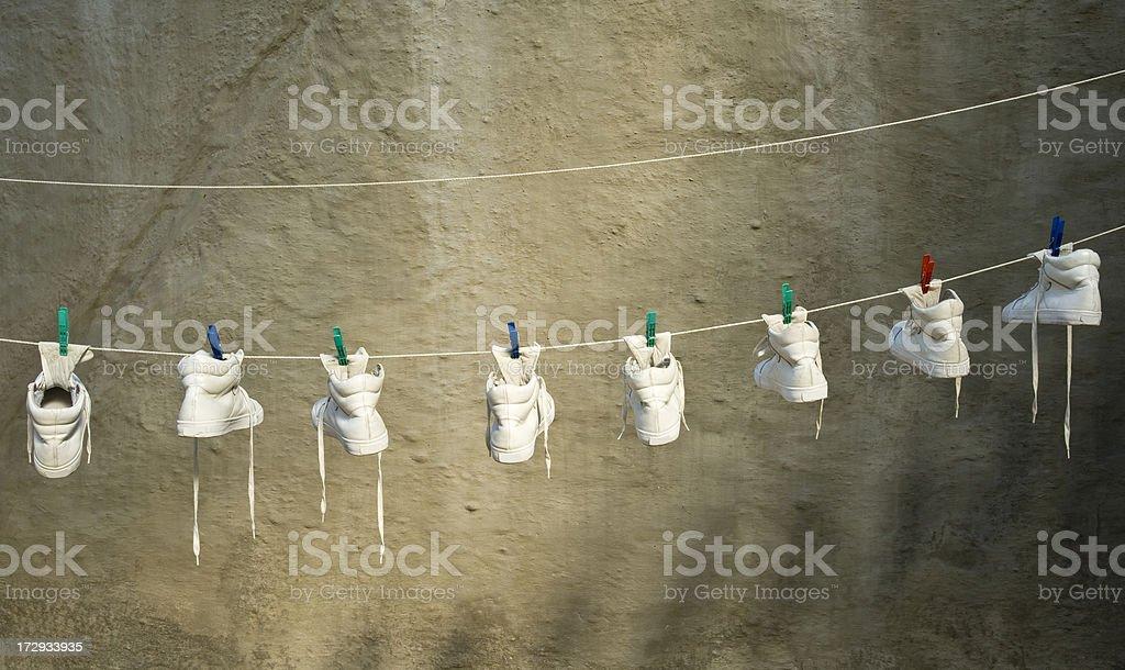 White Sandshoes Drying stock photo