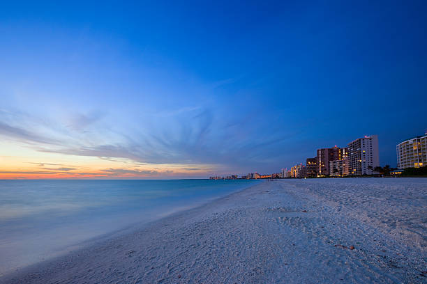 White Sandy Beach Resort at Sunset Row of resorts, hotels on white sandy beach at sunset naples florida stock pictures, royalty-free photos & images