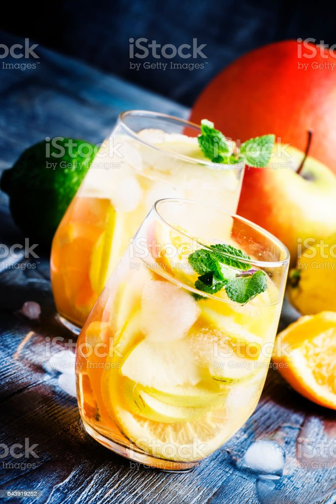 White sangria with fruit and ice stock photo