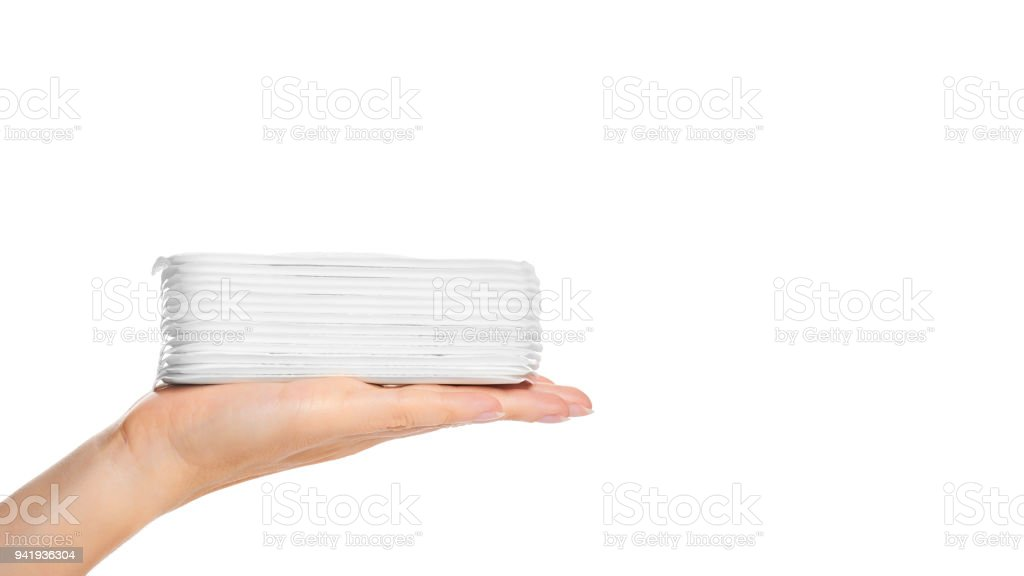 white sanitary napkin in hand isolated on white background. copy space, template stock photo