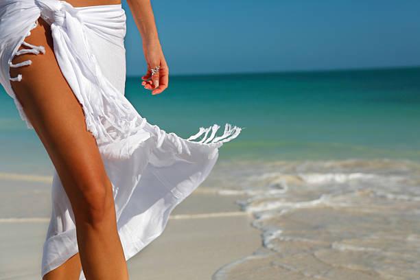 white sarong on beach stock photo