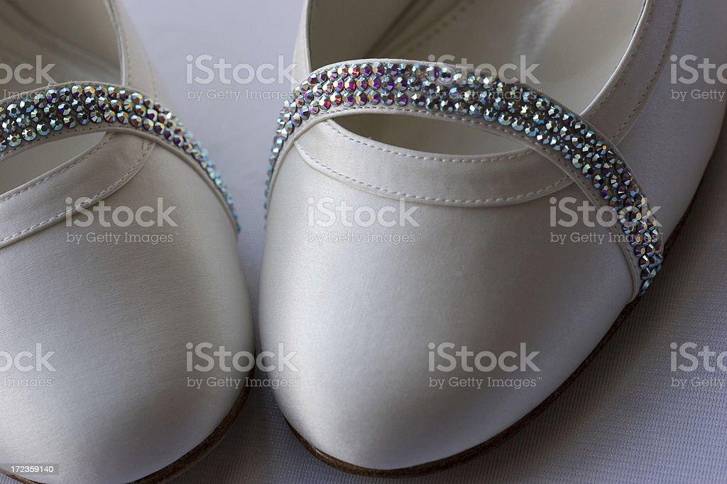 White satin shoes with sparkle detail royalty-free stock photo