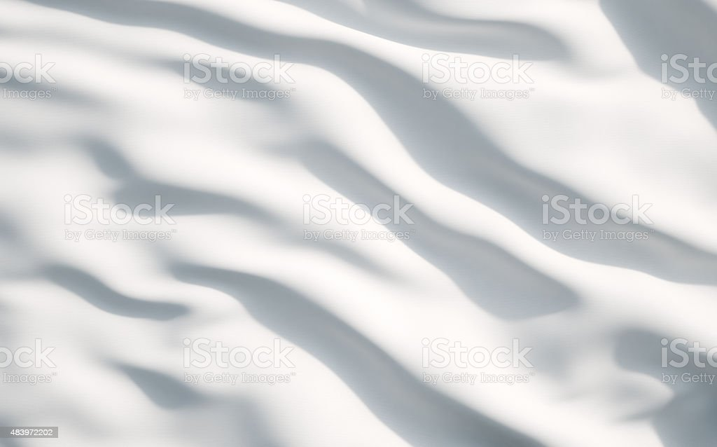 White satin, silk, texture background. A concept of white flag. stock photo