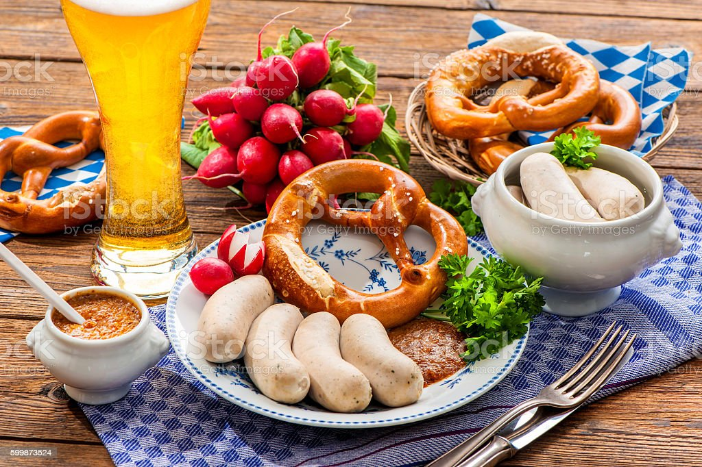 White sausages with sweet mustard and pretzel stock photo