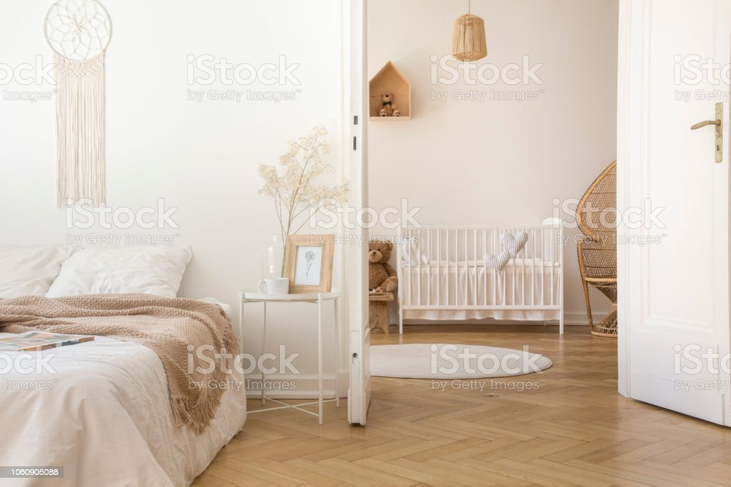 White Scandinavian Bedroom With Door Open To Nursery With Crib And Toys Real Photo Stock Photo Download Image Now Istock