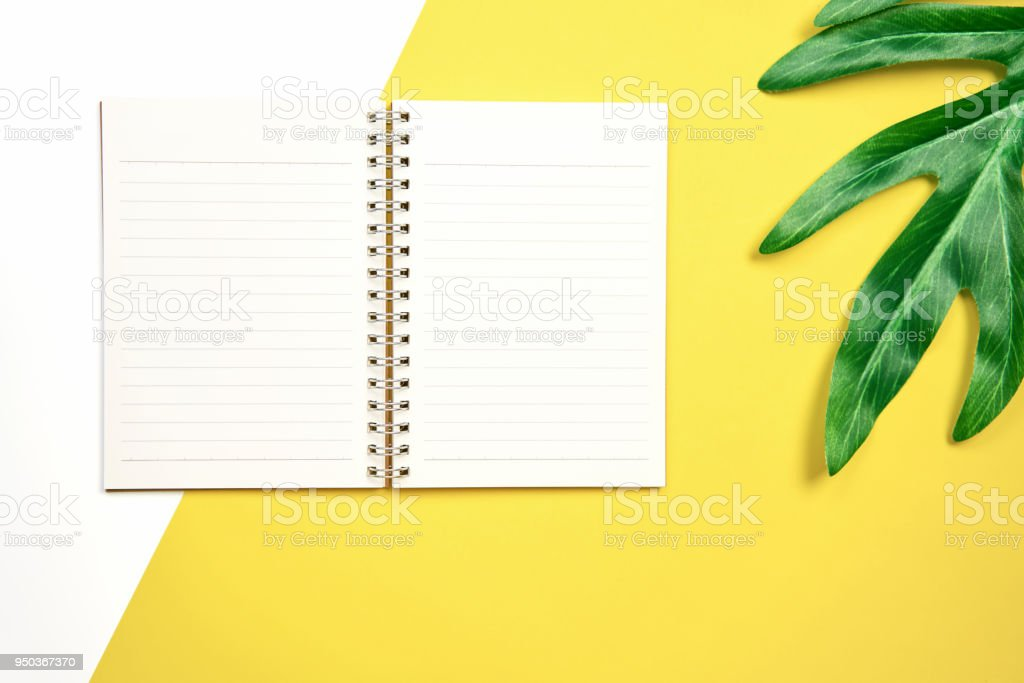 white screen note book blank placed on pastel yellow background....