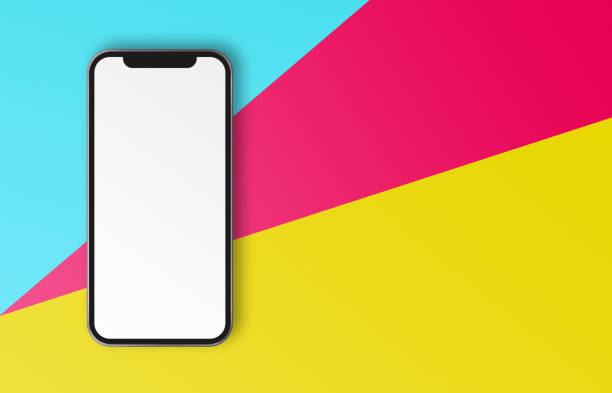 White Screen Smartphone on Colored Papers stock photo