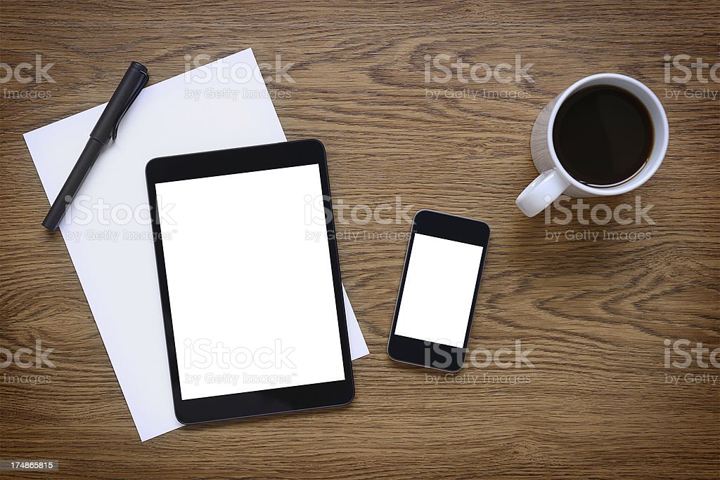 White screen tablet pc and smart phone on desk royalty-free stock photo