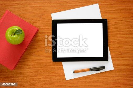 istock White screen tablet pc on office desk 480883931