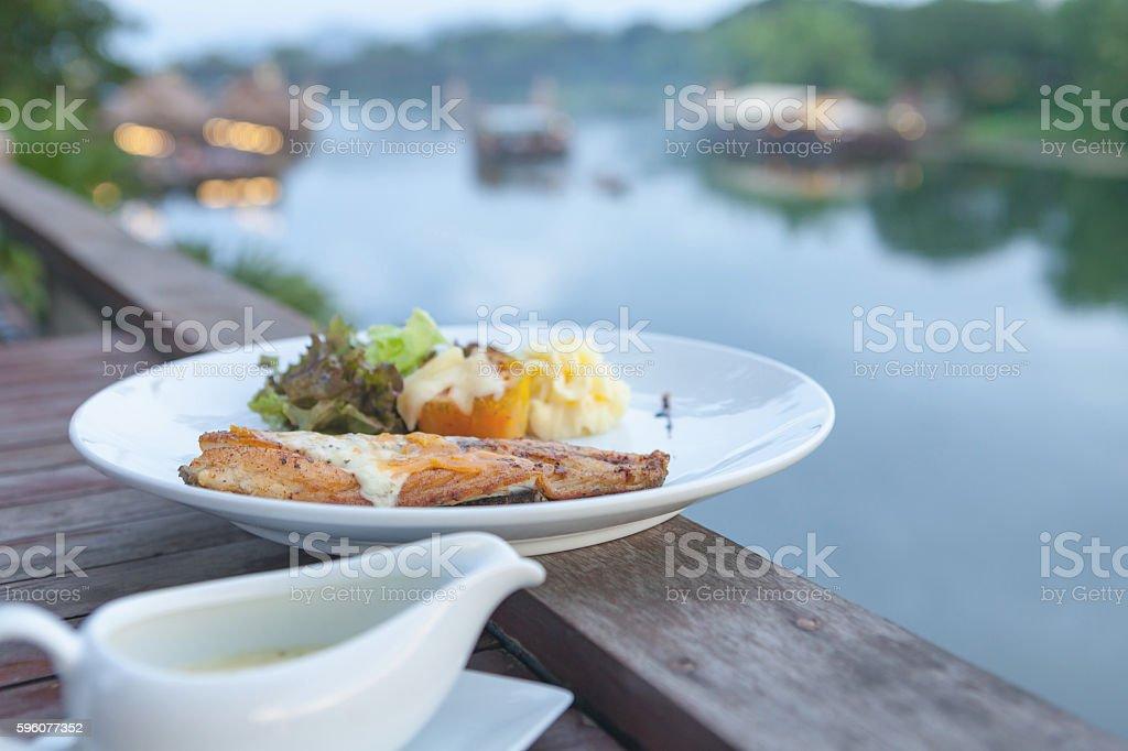 White sea bass steak sauce stock photo
