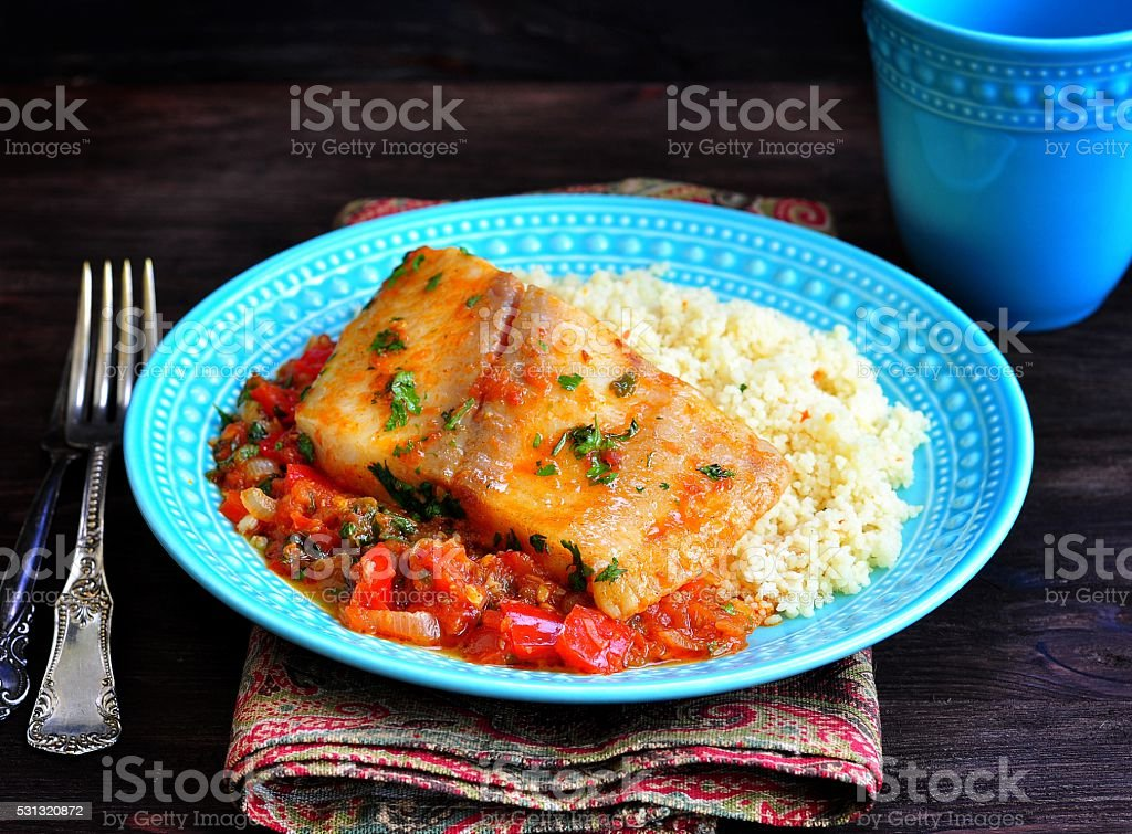 White sea fish cooked in a spicy tomato sauce with stock photo