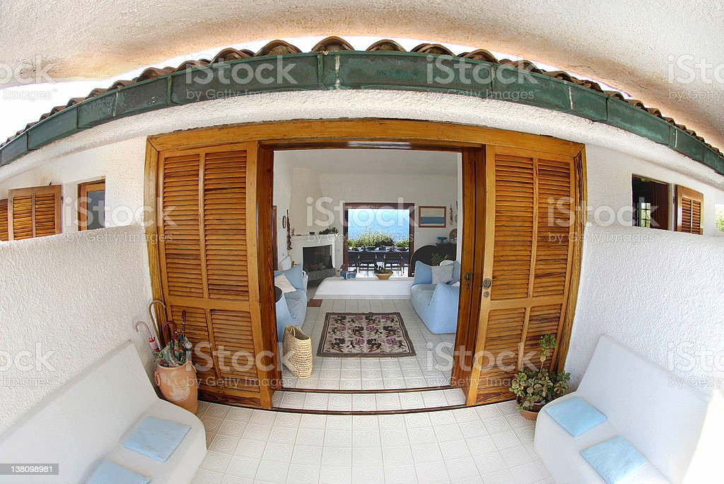 White seaside house, entry, wooden sliding door, fisheye view royalty-free stock photo