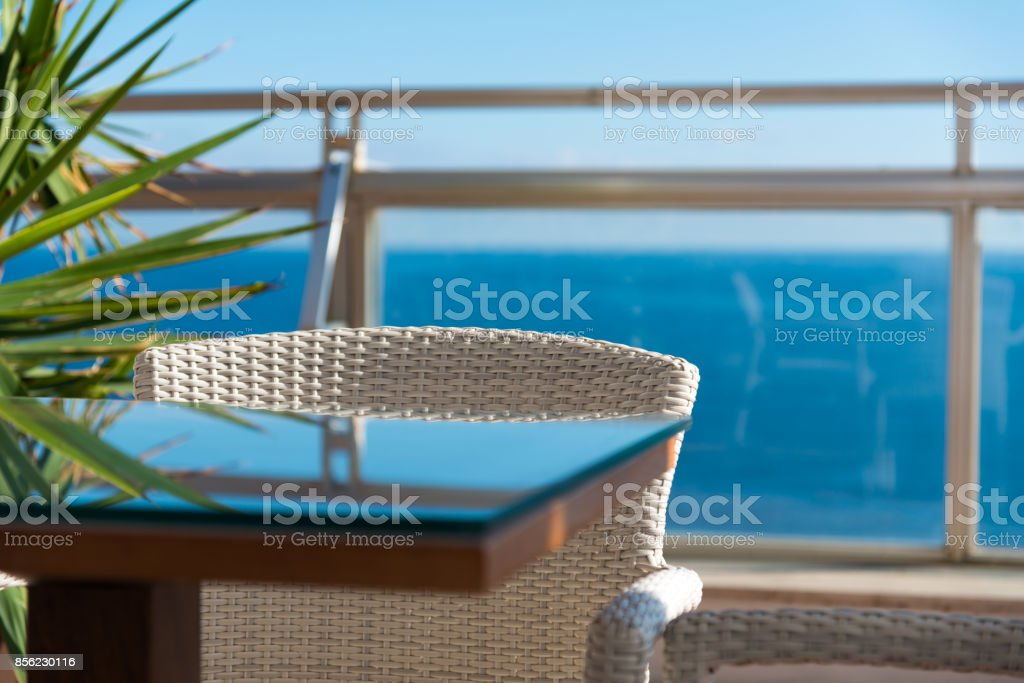 white seat in front of ocean - detail of outside furniture stock photo