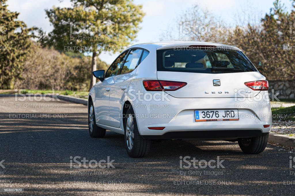 White Seat Leon stays parked among clouds on road of Crete island. Seat Leon is a compact hatchback derived from the Seat. stock photo