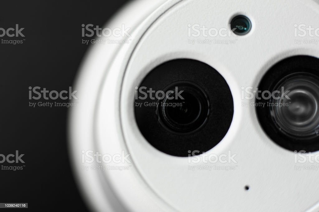 White security cctv dome type camera close-up. Lens and ir stock photo