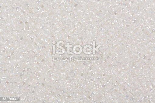 istock White seed beads 872769312