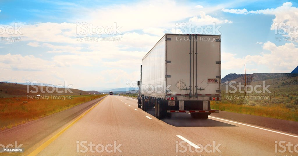 White Semi Truck on the road stock photo