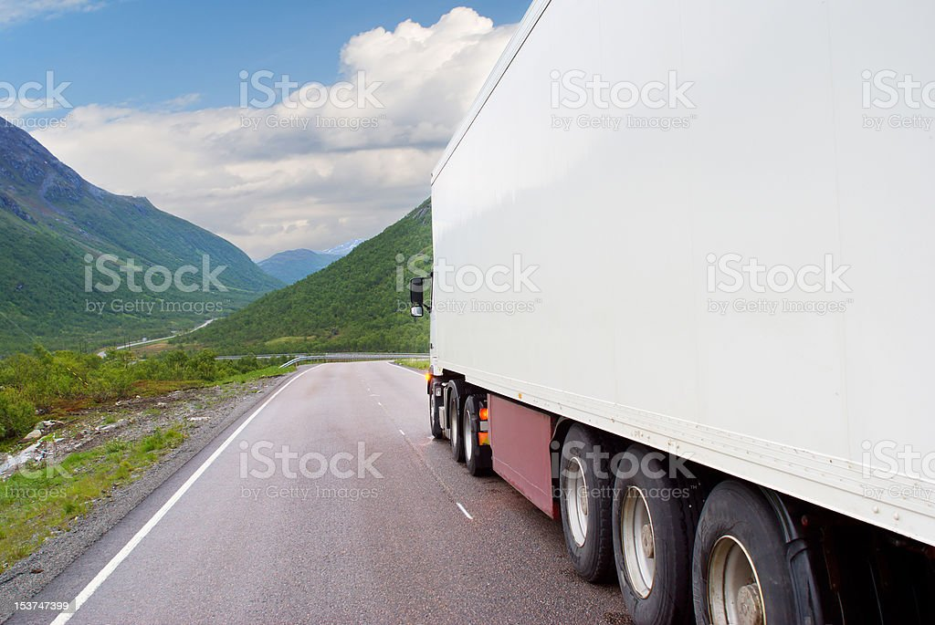 White semi-truck on the mountain road stock photo