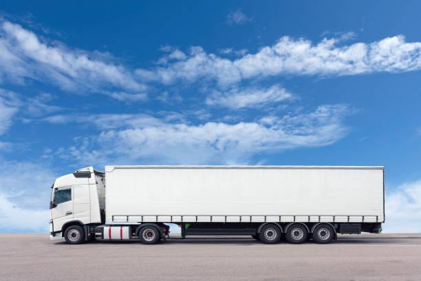 White semi-truck with trailer stock photo
