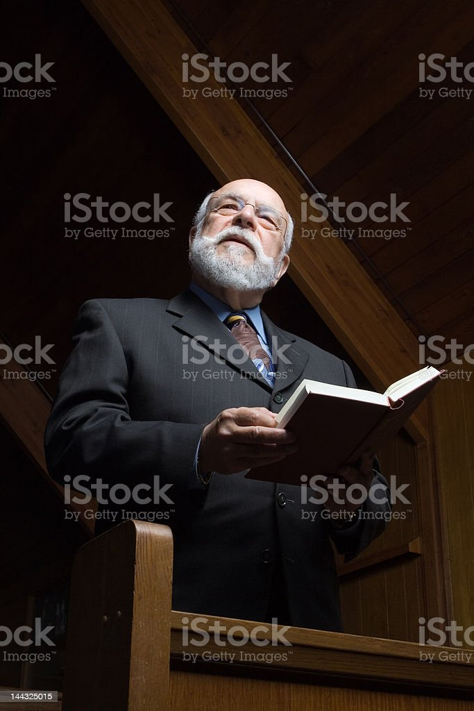 White Senior Mand Standing and Singing in Church from Hymnal royalty-free stock photo