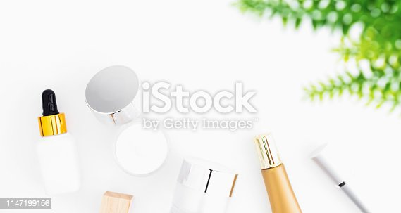 927626522 istock photo White serum bottle and cream jar, mockup of beauty product brand. Top view on the white background. 1147199156