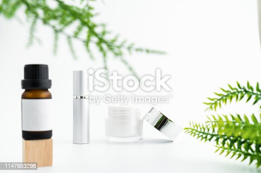 927626522 istock photo White serum bottle and cream jar, mockup of beauty product brand. Top view on the white background. 1147653298