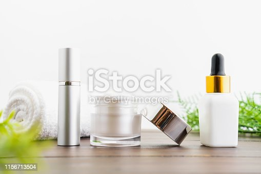 927626522 istock photo White serum bottle and cream jar, mockup of beauty product brand. Top view on the white background. 1156713504