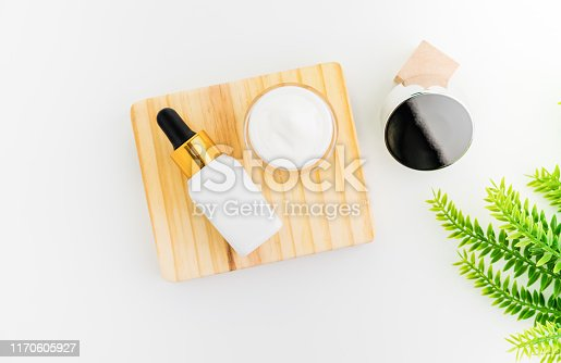 927626522 istock photo White serum bottle and cream jar, mockup of beauty product brand. Top view on the white background. 1170605927