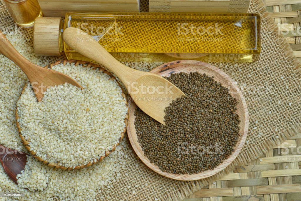 White sesame and Black sesame witn seame oil stock photo