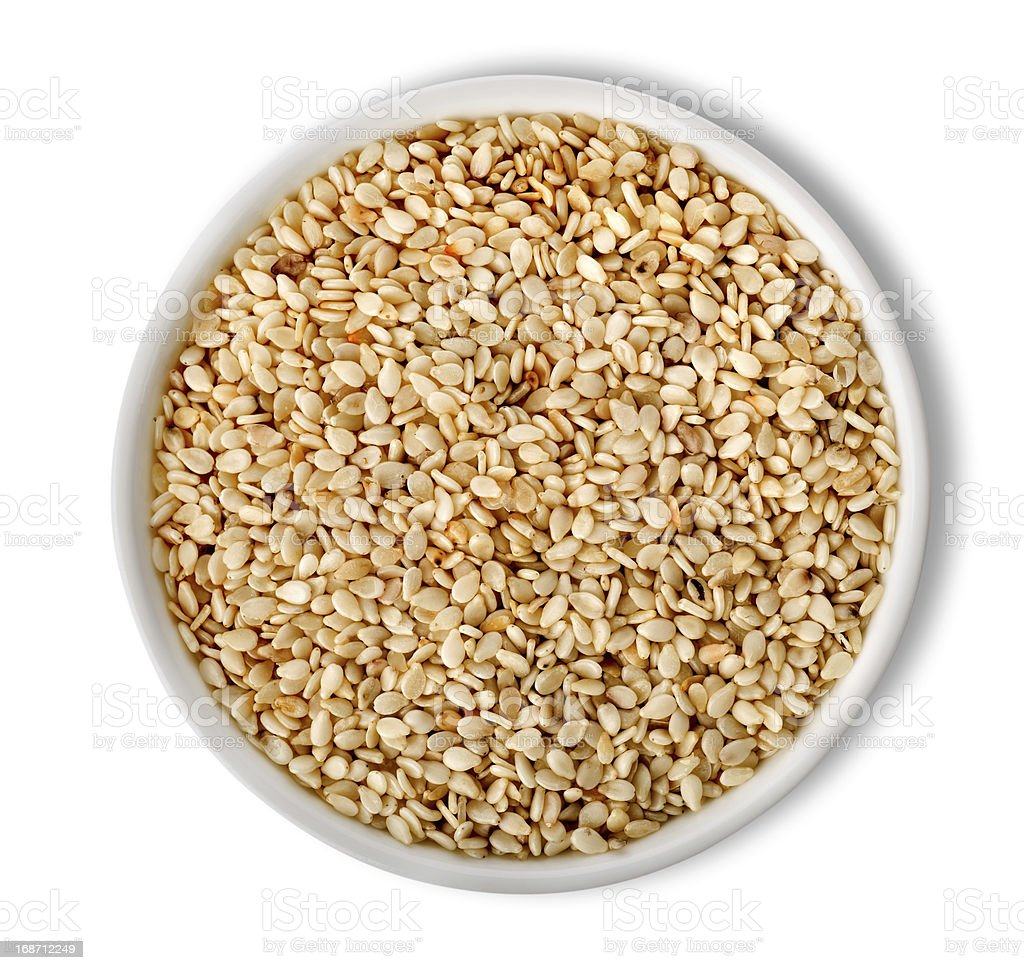 White sesame in plate isolated stock photo
