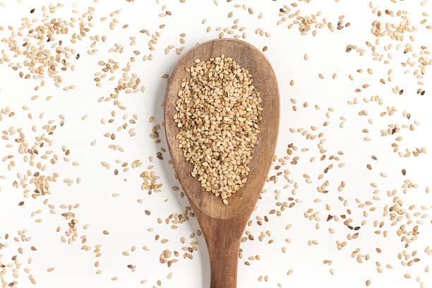 White Sesame into a spoon stock photo