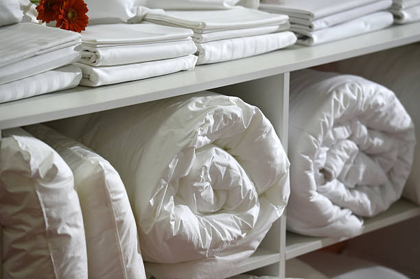 White set of bed sheets stock photo