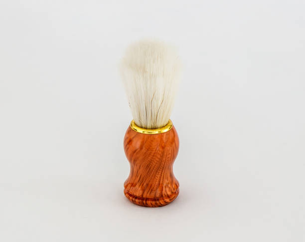 White  shaving brush with wooden handle isolated on a white background stock photo