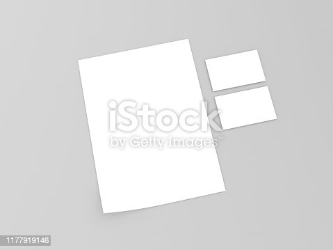 istock White sheet of paper and a business card on a gray background. 1177919146
